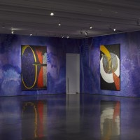 Installation view: Chris Ofili: Night and Day, Aspen Art Museum, 2015. From left: Ritual & Resistance (Desire), 2009; Violet Mirror (Baptist), 2014-2015; Moonbeams, 2015; Cocktail Serenader, 2014. Photo: Tony Prikryl. All works © Chris Ofili. Courtesy the artist, David Zwirner, New York/London and Victoria Miro, London.