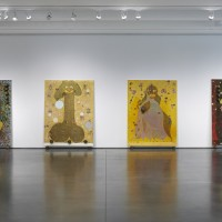 Installation view: Chris Ofili: Night and Day, Aspen Art Museum, 2015. From left: Rodin…The Thinker, 1997-1998; Pimpin' ain't easy, 1997; The Holy Virgin Mary, 1996; Foxy Roxy, 1997. Photo: Tony Prikryl. All works © Chris Ofili. Courtesy the artist, Contemporary Fine Arts, Berlin, David Zwirner, New York/London and Victoria Miro, London.