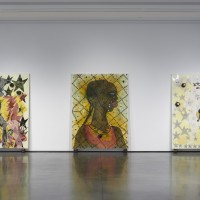 Installation view: Chris Ofili: Night and Day, Aspen Art Museum, 2015. From left: The Adoration of Captain Shit and the Legend of the Black Stars (Third Version), 1998; No Woman, No Cry, 1998; The Naked Spirit of Captain Shit and the Legend of the Black Stars, 2000-2001. Photo: Tony Prikryl. All works © Chris Ofili. Courtesy the artist, David Zwirner, New York/London and Victoria Miro, London.