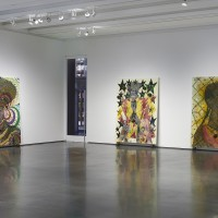 Installation view: Chris Ofili: Night and Day, Aspen Art Museum, 2015. From left: She, 1997; The Adoration of Captain Shit and the Legend of the Black Stars (Third Version), 1998; No Woman, No Cry, 1998. Photo: Tony Prikryl. All works © Chris Ofili. Courtesy the artist, Contemporary Fine Arts, Berlin, David Zwirner, New York/London and Victoria Miro, London.