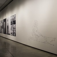 Installation view, Embodied Absence: Chilean Art of the 1970s Now, Carpenter Center for the Visual Arts, Sert Gallery, Oct 27, 2016–Jan 8, 2017. Left: Elías Adasme, To Chile: Art-Actions, 1979–80. Right: Cristóbal Leyht, Sin titulo (Untitled), 2016. Courtesy Carpenter Center for the Visual Arts, Harvard University.