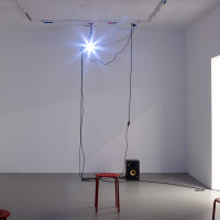 Noah Barker, A Projection in the DDF, 2016. Sound, speakers, video projection, cables, read Ikea chairs, color film on florescent light. Dimension variable. Courtesy of And Now, Dallas. andnow_nb_04 Noah Barker, A Projection in the DDF, 2016. Sound, speakers, video projection, cables, read Ikea chairs, color film on florescent light. Dimension variable. Courtesy of And Now, Dallas. andnow_nb_05 Noah Barker, A Projection in the DDF, 2016. Sound, speakers, video projection, cables, read Ikea chairs, color film on florescent light. Dimension variable. Courtesy of And Now, Dallas.
