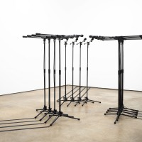 Barricade #3, 2016. 12 microphones and microphone stands and matching audio equipment. Variable dimensions. Photo by Jesus Petroccini. Courtesy of Spinello Projects.