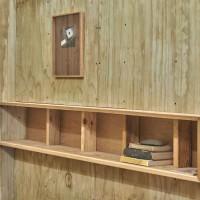 Jorge González, Bookshelf after Casa Klumb, 2016. Decorative plywood ceiling panel with selected texts. Dimensions variable. Courtesy of Embajada, San Juan.