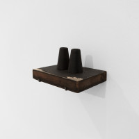 María Edwards, Verse VII - Punto, 2017. Two black steel cones, two rusty bicycle spokes and pitt pencil on a wooden blackboard-shelf. 6.5 x 13 x 10 cm (2.5 x 5.1 x 3.9 in). Courtesy: Arróniz Arte Contemporáneo. Photo credit: Otmar Osante.