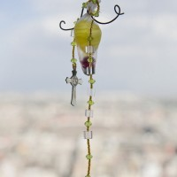 Antoine Donzeaud, To remember me by (Condesa gris-gris), 2017. Vinyl, oil, flowers, quartz, beads, rosary, headphone wire. Variable dimensions. Courtesy of the artists.