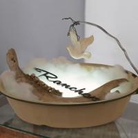 Hayley Silverman, Mercy, 2017. Enamel basin, polyester stuffing, horse jaw bone, 1950 Ford Ranchero badge, porcelain dove, led light. 49 x 33 x 30 cm. Courtesy of the artists and BFA Boatos Fine Arts.