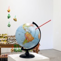 Soft Drink, 2016. Plastic globe with plastic straw. Courtesy MOCAD and the artist.