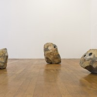 The Weight of the Cave, 2016-17. Six modified granite rocks, pulverized granite paint. Dimensions variable. Courtesy the artist and Commonwealth and Council. Photo: Ruben Diaz.