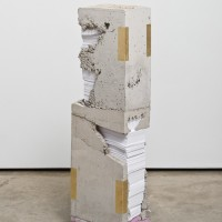 Lucas Simões, White Lies 2, 2017. Concrete, paper, steel, gold leaf, and insulating sheathing. 38-3/4 x 12 x 7-3/4 inches. Courtesy of the artist.