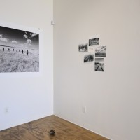 Installation view (from left to right): The Big Trail (Arrow), 2017. 62 x 44 in; Mood Board #01, 2017. 5 unique photographies & one handwritten text. Courtesy of the artist.
