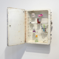 Tim Hawkinson, World Clock, 2012, Medicine cabinet, ace bandage, lotion bottle, prescription medicine bottle, dental floss, deodorant, toothbrushes, plastic cup, pump soap bottle, nail clipper and clock motors 25 1/2 x 16 x 21 inches (64.8 x 40.6 x 53.3 cm) .Photo courtesy of the artists and Steve Turner Contemporary.