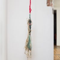 The Binding/El amarre, 2017. Nylon fishing net, lead weights, hand-dyed cotton cord, hand-dyed jute cord, leather whips, jute thread, dry cattails, seeds, plastic sack. 111 x 9 x 8 in. Courtesy the artist and Commonwealth and Council. Photo: Ruben Diaz.