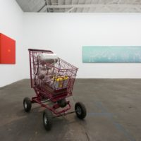 Shopper Hopper, 2016. Mixed media, chromaluscent paint and flake on shopping cart with hydraulics, 42 x 40 x 36. Courtesy Royale Projects, Los Angeles