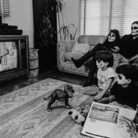 Laura Aguilar, At Home with the Nortes, 1990. Gelatin silver print, 16 x 20 inches. Image courtesy of the artist and the UCLA Chicano Studies Research Center. © Laura Aguilar.