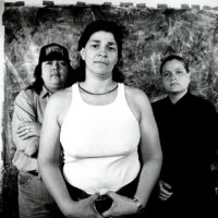 Laura Aguilar, Plush Pony #2, 1992. Gelatin silver print, 11 x 14 inches. Image courtesy of the artist and the UCLA Chicano Studies Research Center. © Laura Aguilar.