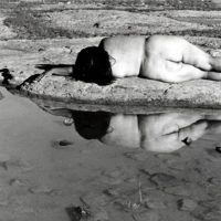 Laura Aguilar, Nature Self-Portrait #10, 1996. Gelatin silver print, 16 x 20 inches. Image courtesy of the artist and the UCLA Chicano Studies Research Center. © Laura Aguilar.