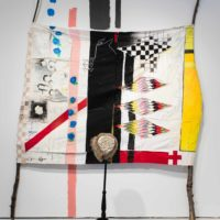 Natalie Ball, June 12 & 13, 1872, 2015. Oil stick, marker, acrylic, graphite, charcoal, cotton, canvas, wool, lodge pole pines, coyote head & fur, bone pipes, leather, wool, brass army buttons, and wood. 96 x 120 inches. Courtesy the artist. Photo: Colin Conces