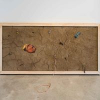 Rafa Esparza, New American Landscapes. Self Portrait: Catching Feelings (Ecstatic), 2017. Wood, bailing wire, adobe (Omaha dirt, Elysian Park, Los Angeles dirt, horse dung, hay, water) scorched twigs, condom wrappers, glass chard, synthetic and agave fiber rope, dry roots, acrylic paint. 48 x 84 inches. Courtesy the artist. Photo: Colin Conces