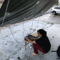 Joel Yoyo Rodriguez, Toldo #3 July 27, 2018. Sound installation and performance with tarp. Photo courtesy: Manuel Mendoza