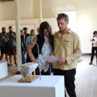 Gala Porras-Kim: Trials in Ancient Technologies at Headlands Center for the Arts: visitors with Untitled (Water Erosion); photo: Apollonia Morrill