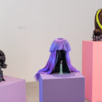"""Young Joon Kwak, Vaginis Head Wig II-IV, 2018, Ceramic, paint, custom-made wig Stylist Rosario Ribera from """"Hollywood Wigs"""" owned by Christine & You. Courtesy of Los Angeles Contemporary Exhibitions (LACE). Photo by Chris Wormald"""
