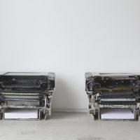 Mechanical Stratification. Fotocopiadora partida en dos. Fotografía: Bruno Viruete. Cortesía de Ladera Oeste