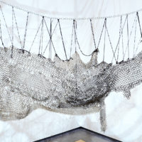 Not So Good for Emperors(detail), 2017. Braided derby rope, knit and crocheted para-cord and yarn,chainmaille, hardware. Courtesy the artist