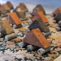 Women are Bricks (Mobile Bricks) (detail), 1983 – remade 2017. Handmade bricks, rug, cement, 107 x 138 inches. Courtesy the artist. Photo: Colin Conces