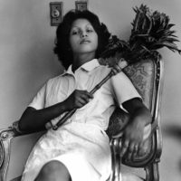 Sandra Eleta (Panamanian, b. 1942), Edita (la del plumero), Panamá (Edita [the one with the feather duster], Panama), 1977, from the series La servidumbre (Servitude), 1978-79. Black-and-white photograph. 19 × 19 in. (48.3 × 48.3 cm). Courtesy of Galería Arteconsult S.A., Panama. ©the artist.