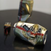 Untitled (Medalla cans) from the series Mine your own business, 2018. Plastic bottle with digital screen chip insert, wifi receiver, 9 volts battery. 4 x 8 x 5.5 inches. Image courtesy of Embajada