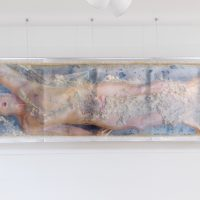Genevieve Belleveau, Pressed Matt, 2018. Archival pigment print, acrylic sheeting, liquid latex, silicone lube, polyester. 25.5 x 81 inches. In partnership with model Matt Savitsky, printmaster Elizabeth Preger and drone photographer Themba Alleyne. Courtesy the artist and Garden, Los Angeles