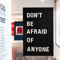 Laurie Anderson/A.M, Homes Don't be afraid of anyone (2018). Felt banner. Image courtesy of Artpace