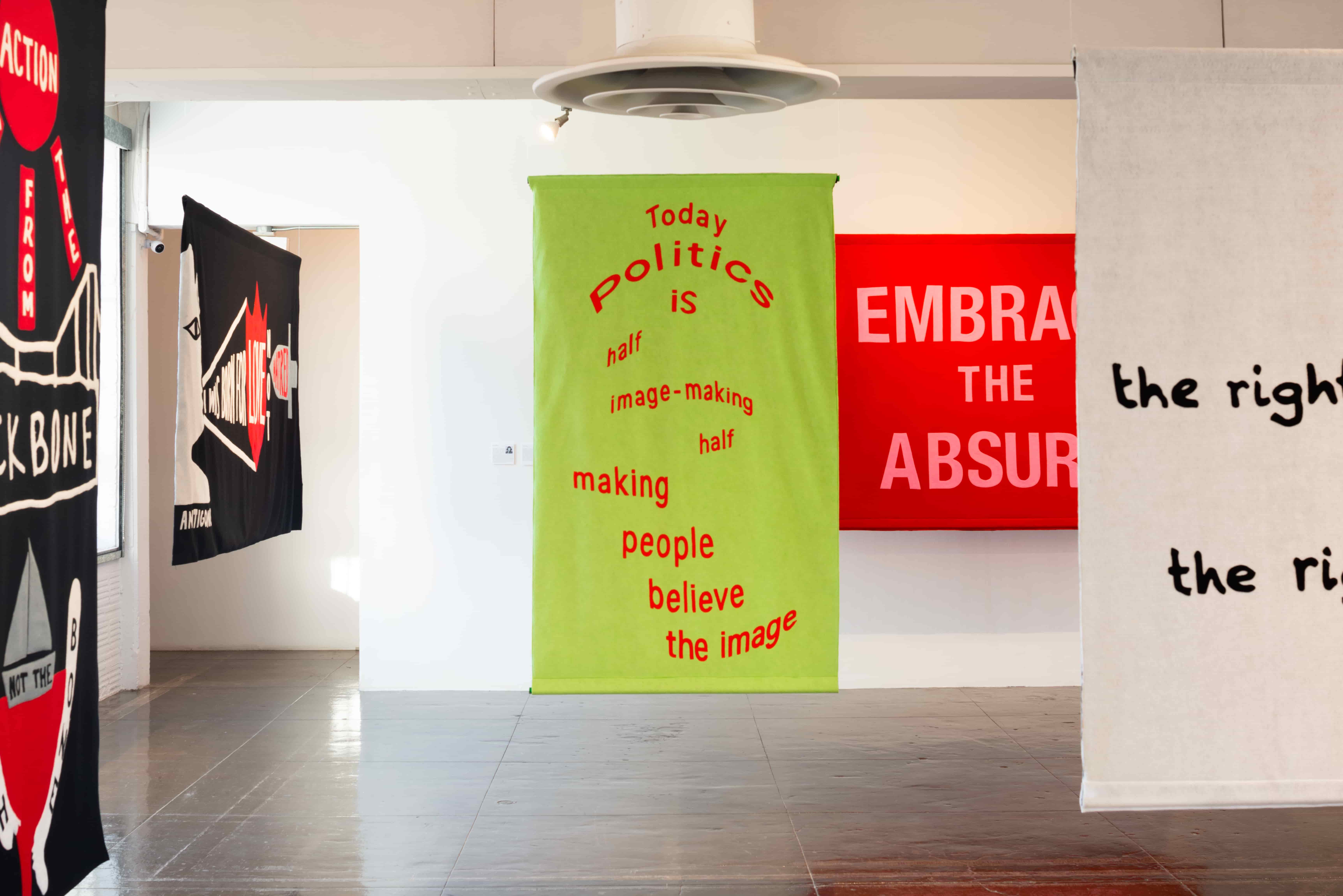 Tania Bruguera, Today politics is half image-making half making people believe the image (2018). Felt banner.Image courtesy of Artpace
