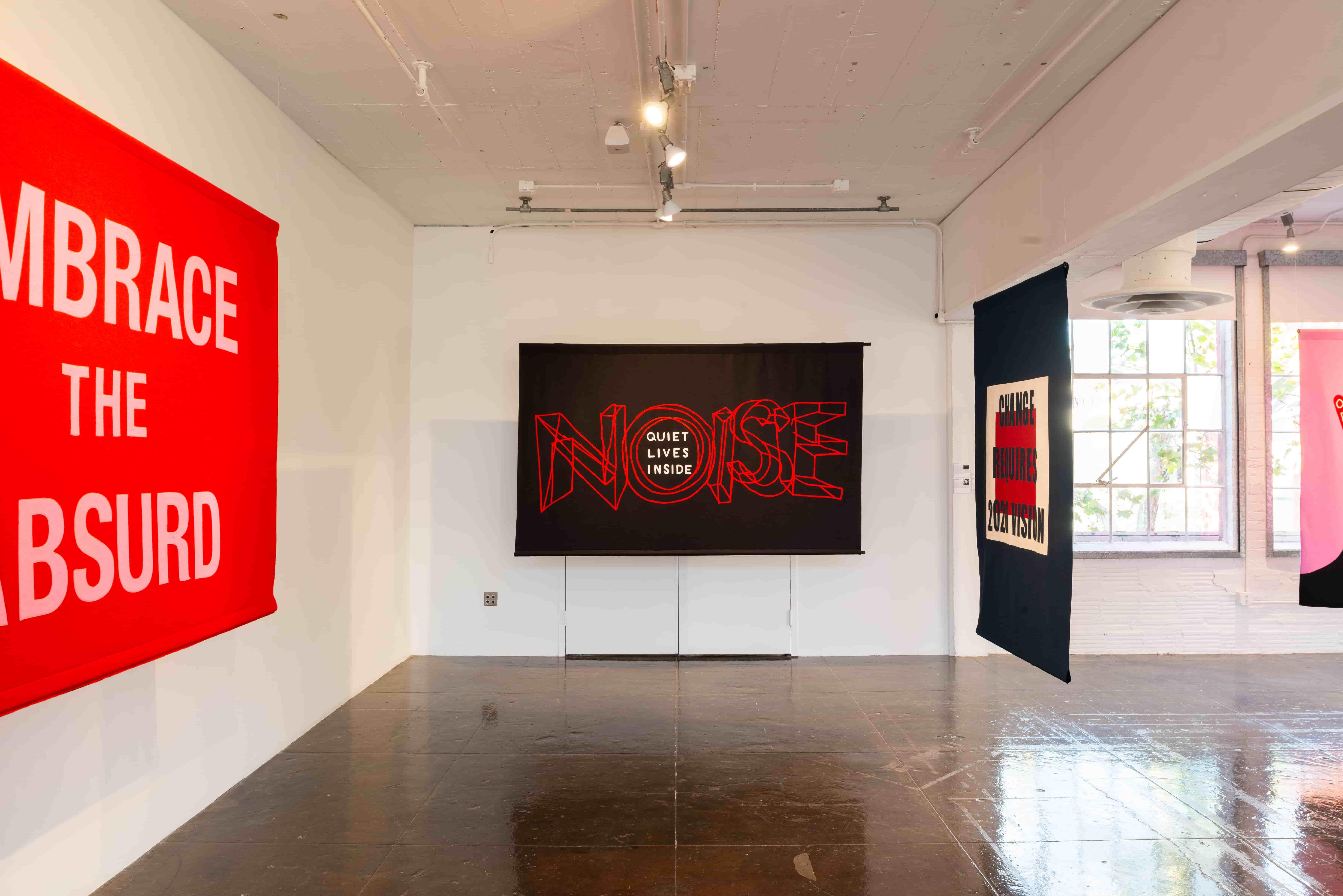 Naomi Shihab Nye/House of Trees, Noise quiet lives inside (2018). Felt banner.Image courtesy of Artpace