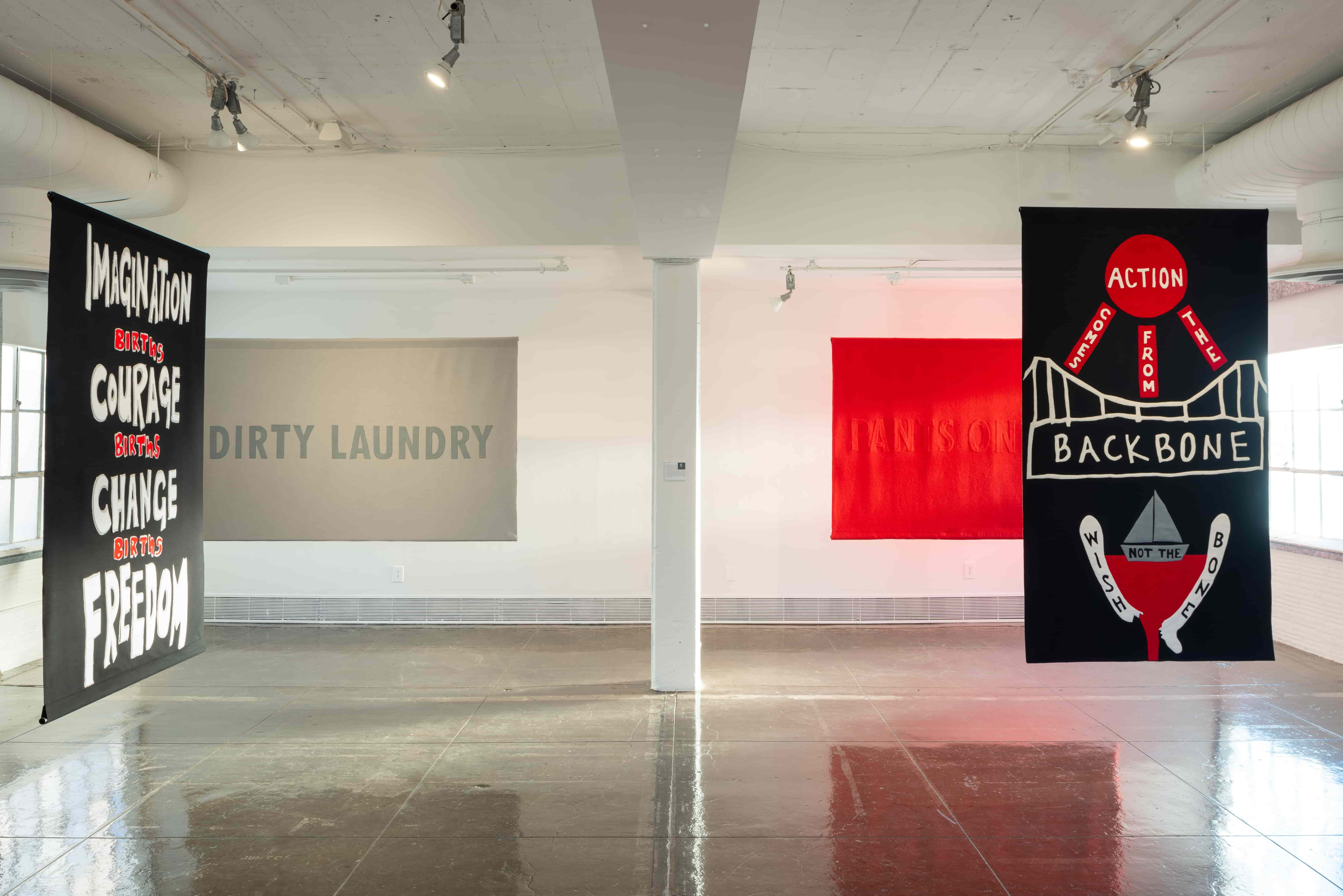 Wangechi Mutu, Imagination births courage births change births freedom (2018); Jenny Holzer, Dirty laundry/follow the money (2018); Jenny Holzer, Pants on fire (2018); Anne Carson/Amy Khoshbin, Action comes from the backbone not the wishbone (2018). Image courtesy of Artpace