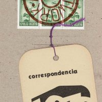 Edgardo Antonio Vigo, Correspondencia (Correspondence), from Mútiples Acumulados (Accumulated Multiples) (1973). Rubber stamps, postage stamps, cut paper, and purple string on cardboard, 9 1/4 x 4 13/16 in., Blanton Museum of Art, The University of Texas at Austin, Gift of the Artist, 1995