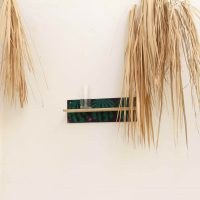 Rodrigue Mouchez, Copo Melancia (2019). Glass, gouache, wood, nails, humidity, 36 x 10 x 10 cm. Exhibition view of Litro por kilo, Massapê Projetos, São Paulo, Brazil, 2019