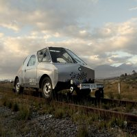 SEFT-1 (Sonda de Exploración Ferroviaria Tripulada) [Abandoned Railways Exploration Probe], On the tracks with the Citlaltépetl (Pico de Orizaba) volcano in the background, 2010. Photo courtesy of the artists.