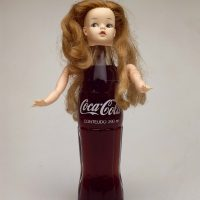 Barrão, Mulher Coca-Cola / Coca-Cola Woman (1987). Bottle, arms and head of figurine. © Barrão. Photo: Fabio Vidigal.