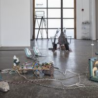 Fernando Palma Rodríguez Ahuaxtli (2019). Volcanic stone, mechanical material, robotic hands, irons, kettle, water tower, water from the Rio Grande, electronic controller, oil barrel, remote control car, software. Courtesy the artist, Ballroom Marfa, and House of Gaga. Commissioned by Ballroom Marfa. Photo by Alex Marks