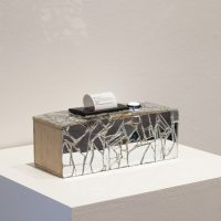 Beatriz Cortez, The Untimely Conversation Box (2015). Wood, broken glass, Arduino UNO, thermal printer, thermal paper, push button. Courtesy the artist, Ballroom Marfa, and Commonwealth and Council. Photo by Alex Marks