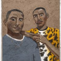 Rafa Esparza,Hector and Jose Polio as Hero Twins: Hunahpu and Xbalanque(2019). Acrylic on adobe panel (local dirt, horse dung, hay, Hoosic River water, chain-link fence, plywood). Image courtesy ofMASS MoCA. Photo byKaelan Burkett