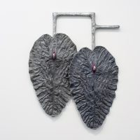 Karen Lofgren, Like This I See You in Dreams (como lo cura, locura), 2018, polyurethane castings of Amazonian medical plant leaves (la pataquina negra), aluminum powder, embedded wool, fiberglass, on cast aluminum. Courtesy the artist and Royale Projects