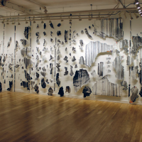 Falls to Leads' installation view, at BmoCA Boulder Museum of Contemporary Art, Colorado, curated by Mardee Goff, 2017. Layers removed from the mural From the Depths of Time (intervention performed at Museo Universitario del Chopo) and 4-inch nails on the wall. Image courtesy of the artist