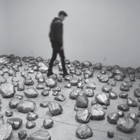 Specific Weight's installation view at Arróniz, Mexico City, 2013. Recycled plastic bags intervened with graphite dust and placed empty on the floor. Image courtesy of the artist and the gallery