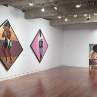 Installation view, RELATIONS: Diaspora and Painting, 2020, PHI Foundation. From left to right: Barkley L. Hendricks, Anthem, 2015; Barkley L. Hendricks, JohnWayne, 2015. Courtesy of the Estate of Barkley L. Hendricks and Jack Shainman Gallery, New York; Larry Achiampong, Holy Cloud (Mighty Jesus), 2014. Courtesy of the artist and Copperfield, London © PHI Foundation for Contemporary Art, photo: Richard-Max Tremblay