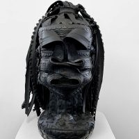 Kim Dacres, Untitled (Rude One) (2020). Auto tires, bicycle tires, wood, screws, spray paint. Image courtesy of GAVLAK