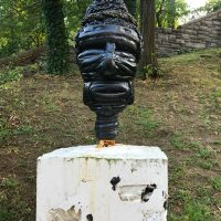 Kim Dacres, Peaceful Perch (2018-2019). Bust: Auto tires, bicycle tires, inner tubes, wood, screws, spray enamel; Base: Hydrocal (white cement) and rubber bits. Image courtesy of GAVLAK